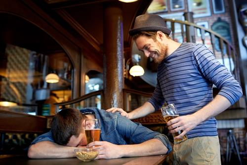 16895282-male-friends-drinking-beer-at-bar-or-pub